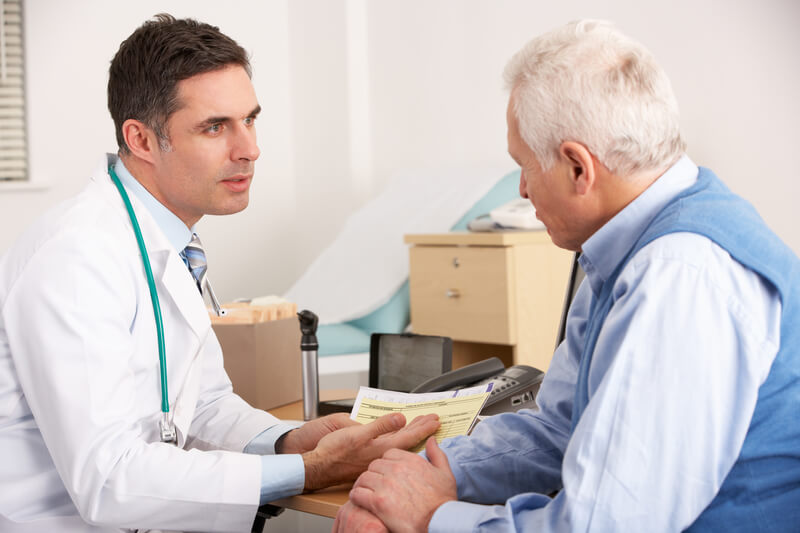 A physician discussing a difficult topic with a patient